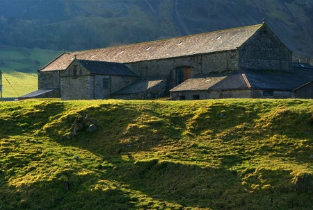 Exterior of traditional English stone farmhouse in countryside with mountains in background. Stock Photo - 6923068