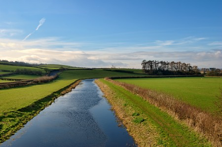 Scenic view of Lancaster Canal receding through countryside, Farleton, Cumbria, England. Stock Photo - 6923073