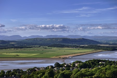 fells: A view from Arnside Knot, a beauty spot in Cumbria, Northern England. The Kent Estuary, Arnside Viaduct, and the Lakeland Fells Stock Photo