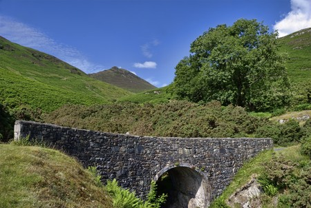 newlands: A small stone bridge over Stonycroft Gill in the Newlands Vally, Stair, Cumbria, English Lake District