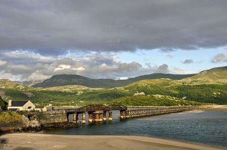 Barmouth Bridge crossing the Mawddach estuary. Gwynedd, North Wales
