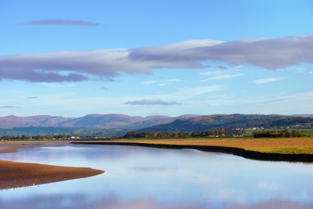 fells: A morning view of the shoreline at Arnside, Cumbria, England, with the Lake District Fells in the distance