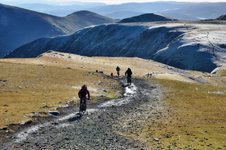 extreme terrain: A group of mountain bikers near the summit of Helvellyn, in the English Lake District Stock Photo