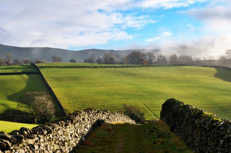 drystone: a path through dry-stone walls, Staveley, Cumbria, in the English lake District Stock Photo