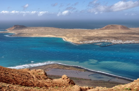 The Island of La Graciosa and the port of Caleta del Sebo taken from the Mirador del Rio, a famous viewpoint on Lanzarote, in the Spanish Canary Islands. Stock Photo - 9159247