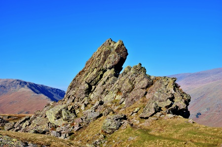 Scenic view the Lion and the Lamb rock formation at summit of Helm Crag; Lake District National Park, Cumbria, England.
