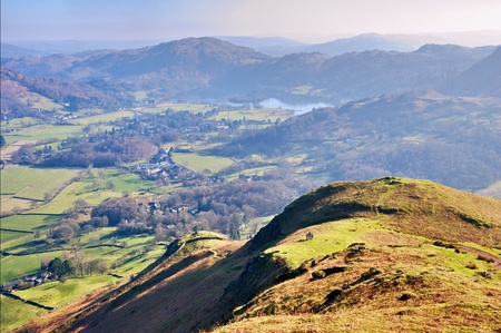 the crag: Scenic view of the Lake District National Park looking over Grasmere from summit of Helm Crag; Cumbria, England. Stock Photo