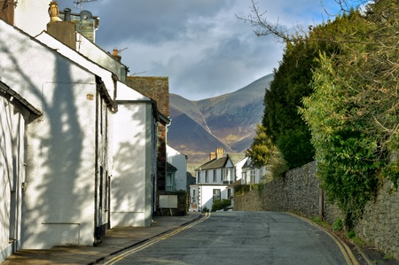 A street  in the English Lake District town of Keswick, with Skiddaw in the background.