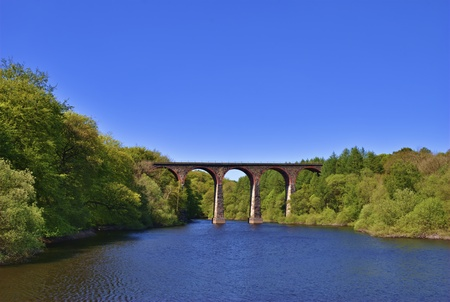 span: Scenic view of Victorian railway viaduct in English countryside. Stock Photo