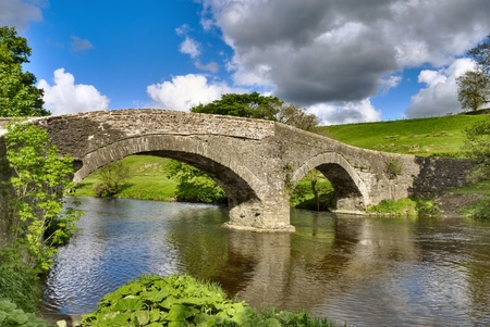 An ancient packhorse bridge on the river Lune near Beck Foot, Cumbria. Stock Photo