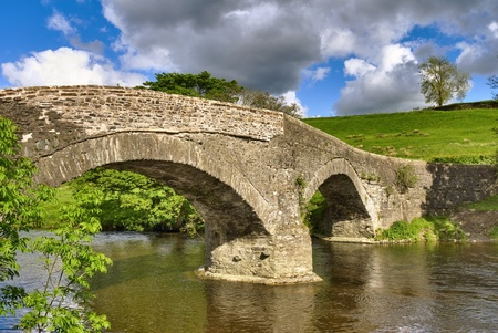An ancient packhorse bridge on the river Lune near Beck Foot, Cumbria. Stock Photo - 9694889