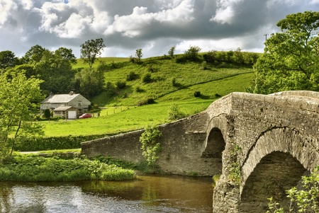 english countryside: An ancient packhorse bridge on the river Lune near Beck Foot, Cumbria. Stock Photo