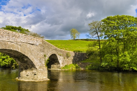 old packhorse bridge: An ancient packhorse bridge on the river Lune near Beck Foot, Cumbria. Stock Photo