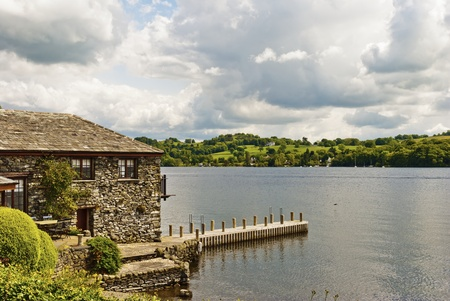 A stone built house on the edge of a lake Stock Photo - 9796426