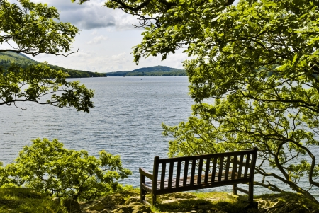 A seat overlooking Windermere at Rawlingsons Nab  in the English Lake District National Park Stock Photo