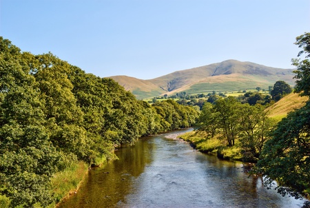 A view of the River Lune, Cumbria, England, with the Howgill Fells in the distance photo
