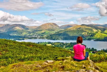 A female hiker overlooking Windermere from the summit of Latterbarrow photo