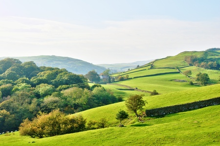 Rolling English countryside around a farm  in the English Lake District National Park, Cumbria Stock Photo