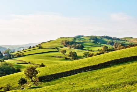 Rolling English countryside around a farm in the English Lake District National Park, Cumbria photo