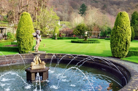 garden fountain: A formal fountain and garden at Rydal Hall, Rydal, Cumbria, a tranquil Christian retreat and holiday destination