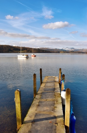 mooring bollards: Boat dock and walkway looking out onto a large blue water lake