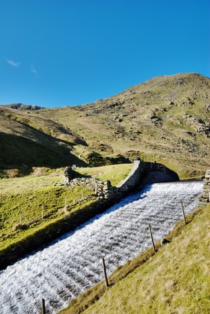 Water flowing down a sluice and spillway in Kentmere, English Lake Disrict Фото со стока - 12766213