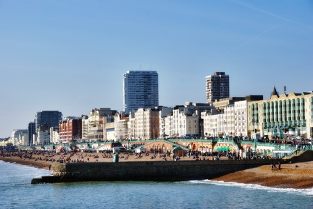 brighton beach: View from the sea of the beachfront and promenade at Brighton, a popular resort town in Britain Stock Photo