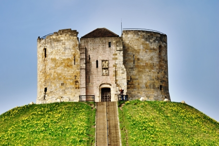 The fortified Norman stone keep at York Castle, England, now a national monument referred to as Cliffords Tower which is open to the public 免版税图像