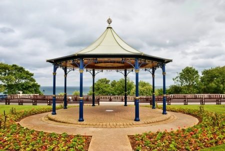 An ornamental English bandstand under an overcast sky in the seaside resort of Bridlington, North Yorkshire