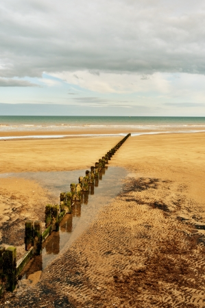 A Sandy beach and a groyne in the seaside resort of Bridlington on the East coast of England Stock Photo - 14839519