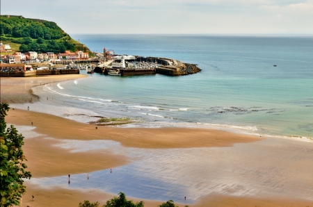An aerial view of  the sandy beach and harbour of Scarborough, a popular holiday destination on the East coast of England Stock Photo - 14839518