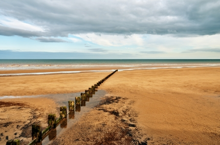A Sandy beach and a groyne in the seaside resort of Bridlington on the East coast of England Stock Photo - 14892831