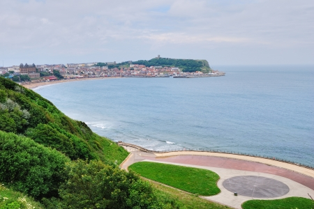 An aerial view of  the sandy beach and bay of Scarborough, a popular holiday destination on the East coast of England Stock Photo - 15160263