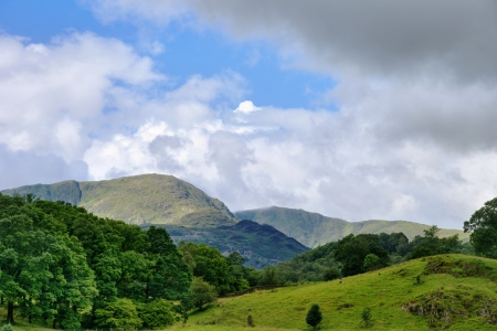 A view of Wetherlam, a mountain in the English Lake District National Park, with rolling wooded countryside Stock Photo - 15326230