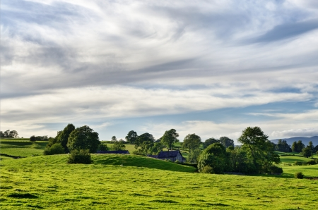 A secluded farmhouse in rolling English Lake District countryside Stock Photo - 15551454