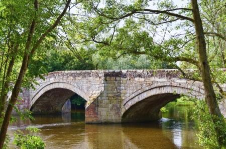 arcos de piedra: Una vista detallada ofPooley Eamont Bridge y el río en el Lake District Inglés