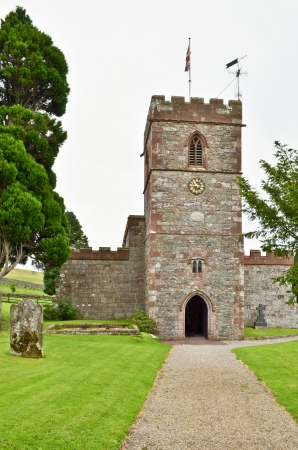 The red sanstone tower of a church in the village of Dacre, Cumbria, Northern England Stock Photo - 15656425