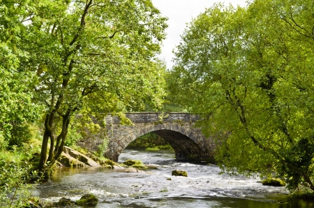 old packhorse bridge: The popular English Lake District destination of Skelwith Bridge surrounded by trees in Summer