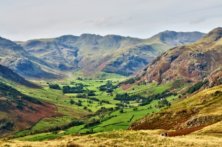 A sweeping view of Langdale, a glaciated valley, set against a backdrop of Bowfell and Crinkle Crags, on a summers day in the English Lake District Stock Photo - 16218350