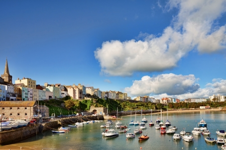 Sweeping view of Tenby harbour with boats, on a summers day with a vivid blue sky and cumulus clouds  Stock Photo - 16569961
