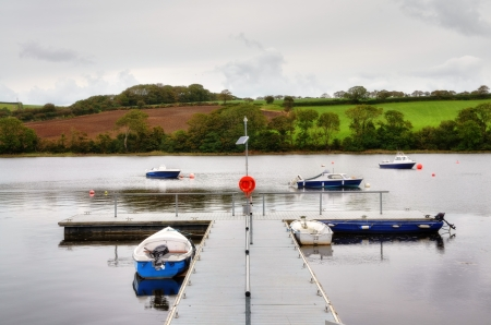 View of a jetty with moored boats, on the tranquil River Teifi,at St Dogamaels, a village near Cardigan, known in Welsh as Llandudoch  Stock Photo - 16720541