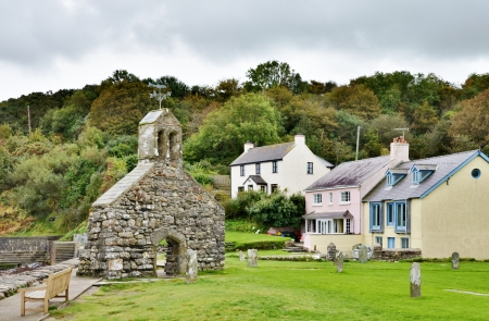 St Brynach s Church; a12th century religious site, with traditional cottages, on the Dinas Head Peninsula at Cwm-yr-Eglwys, Pembrokeshire Stock Photo - 16814151
