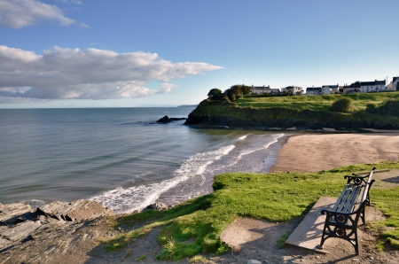 view of the Blue Flag beach at Aberporth, Ceredigion, Wales, with waves breaking onto the sandy shore, and a headland jutting into the sea  Stock Photo - 16814149