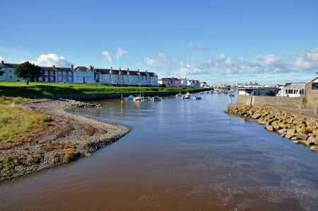 Picturesque vista of the winding River Aeron and Aberaeron Harbour, Ceredigion, Wales, with colourfully painted houses Stock Photo - 16880415