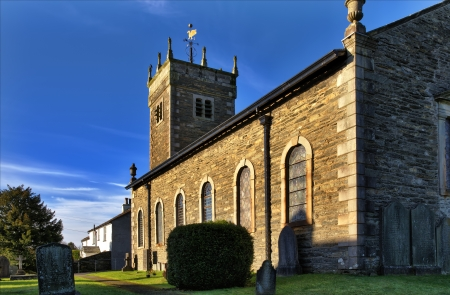 View of the Grade 2 listed St Anne s Church at Ings in Cumbria, built in 1743 with roughly coursed rubble walls, sandstone quoins and window surrounds, and a green slate roof, seen on a sunny autumn day Stock Photo - 17531793