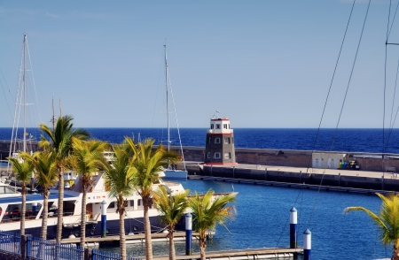 The harbour and lighthouse at Puerto Calero in the Spanish Canary Islands  Stock Photo - 19198564