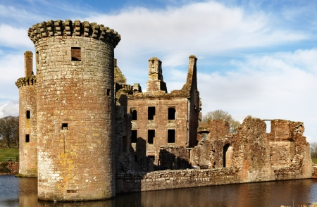 dumfries and galloway: A view of Caerlaverock Castle, Dumfries and Galloway, Scotland, set against a blue sky