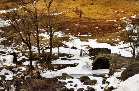 Snowy winter view of High Sweden Bridge, an historic packhorse bridge in the Scandale Valley near Ambleside in the English Lake District Stock Photo - 19683855