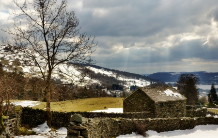 Winter view with snow of a stone built barn by a walled footpath winding up the Scandale Valley near Ambleside in the English Lake District Stock Photo - 19683859
