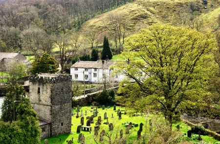 View of Hubberholme, a village in Upper Wharfdale in the Yorkshire Dales, England, with the historic church of St Michael and All Angels